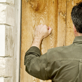 A man knocking on a door.